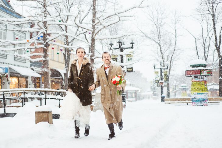 """The ceremony was at a historic hotel in Boulder, Colorado, which served as an elegant backdrop for our vows, and the reception was at a more modern event space a few blocks away which allowed us to have a bit more fun,"" Laura says. ""We especially enjoyed leading a snow-filled walk through the downtown from one venue to the other."""