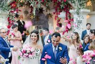 """Marina Gonzalez and Jose Juarez turned their vibrant California wedding into an international affair with the help of the right venue and décor. """"Ranc"""