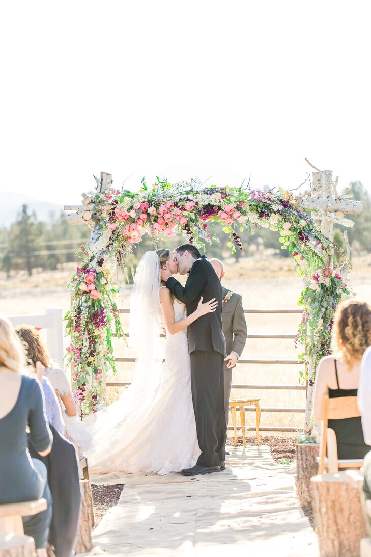 A family friend helped craft the wedding arch with alder branches, eucalyptus and pink blossoms.