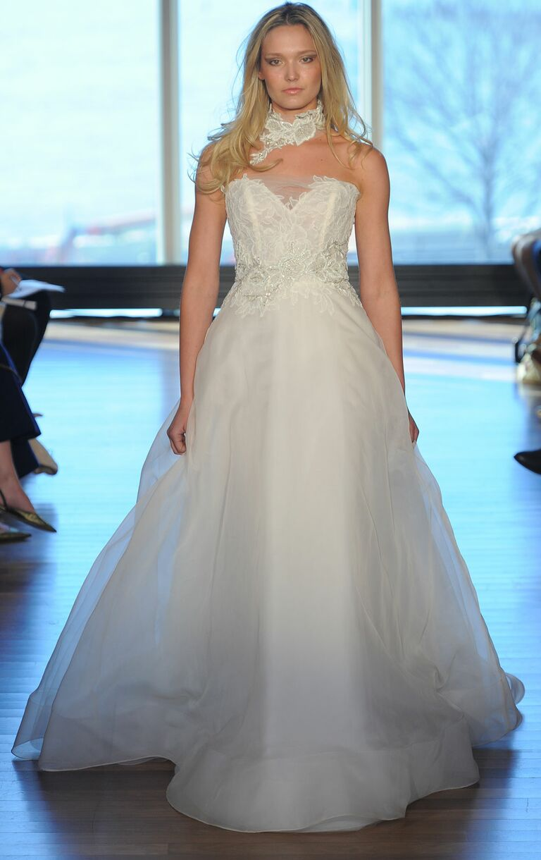 a7f99a39cf Rivini airy organza A-line wedding dress with hand appliquéd floral  Chantilly lace bodice Spring