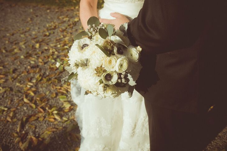 White ranunculuses, dahlias and anemones filled the bridal bouquet.