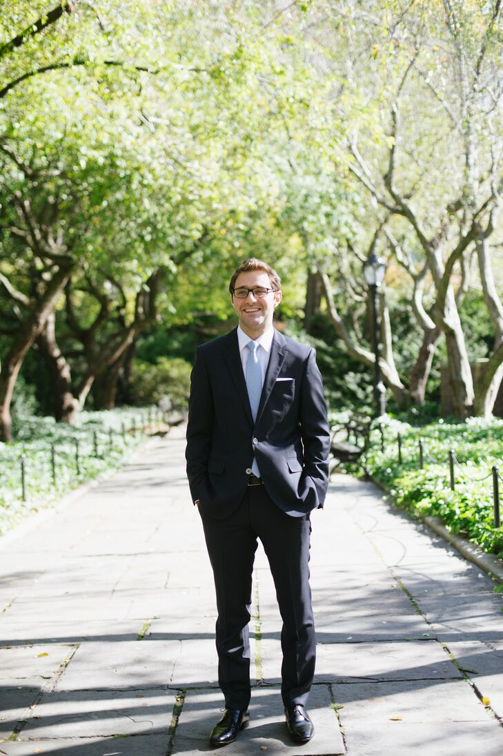 Brian wore a navy Hugo Boss suit with a light blue tie to match his groomsmen, a white button down from Brooks Brothers, and Ferragamo shoes. Instead of navy suits, his groomsmen wore gray.