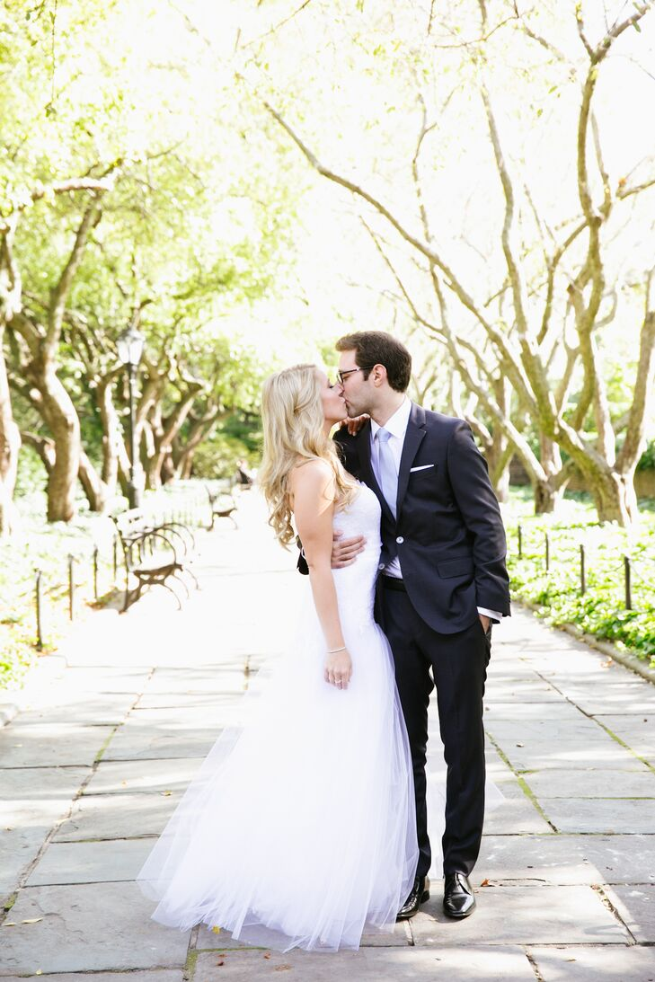 Lillian and Brian traveled to the Central Park Conservancy Gardens before the wedding to take all of their wedding portraits. Lillian wore her hair in loose curls in a soft half-up hairstyle to cover her bare shoulders.