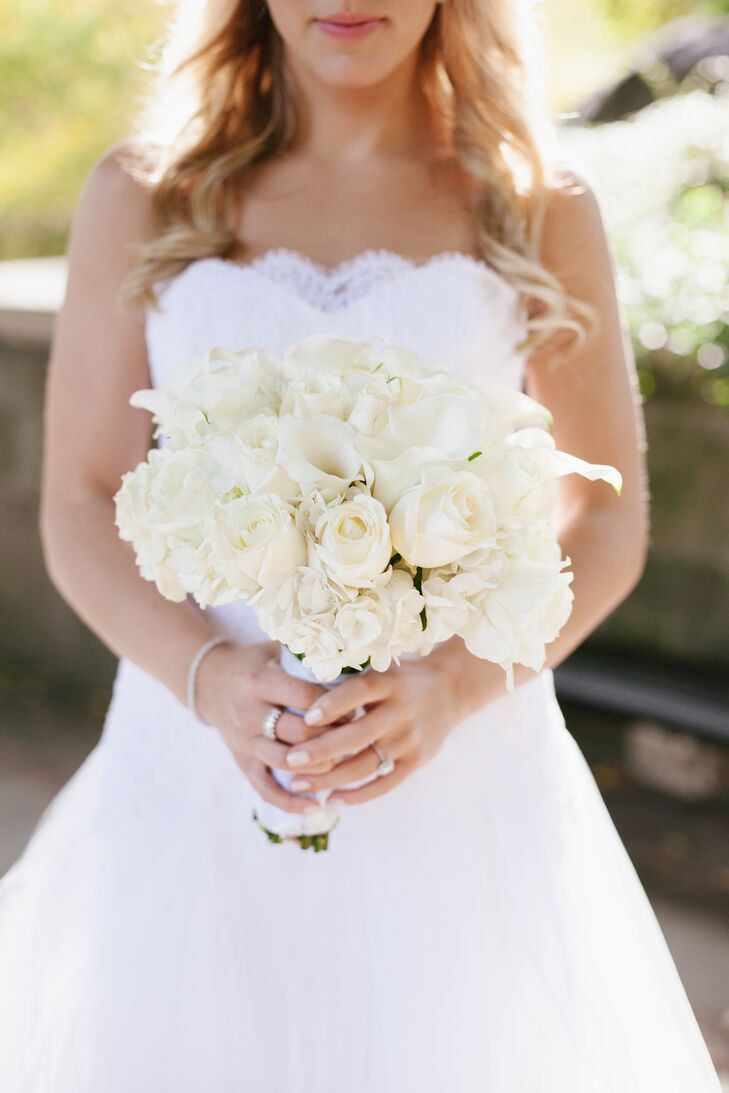 Lillian carried an elegant all-white bouquet of roses, calla lilies, and hydrangeas for a classic bridal arrangement. The couple's florist, Mindy Jacobowitz, utilized many different kinds of flowers throughout the decor, but made sure to include white roses and hydrangeas to tie back into the bride's bouquet.