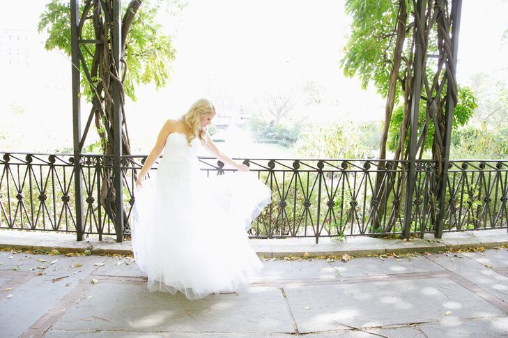 """Lillian wore a strapless ball gown Christos wedding dress with a flowy tulle skirt. """"The best part about my dress was that it was light and comfortable,"""" she says."""