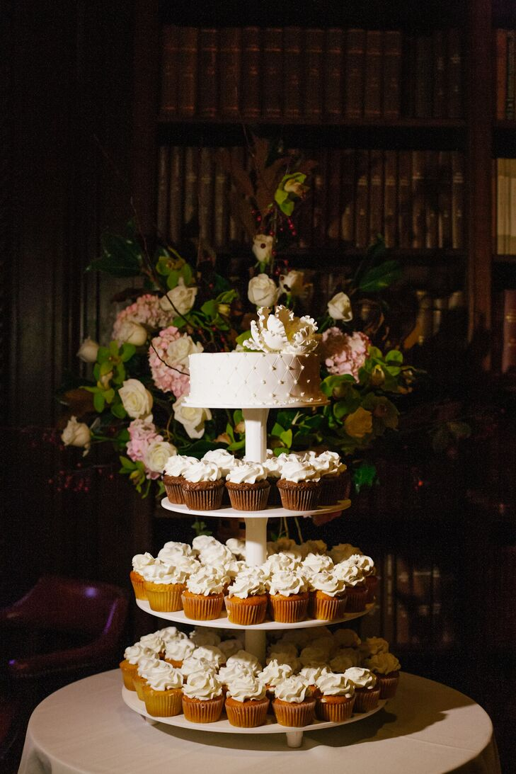 Lillian and Brian served a tremendous selection of sushi, carving stations, Chinese food, Mexican food, duck, hor d'oeuvres, stuffed chicken, and chateubriand. They also had a small cutting cake for dessert atop a simple vanilla-iced cupcake tower.