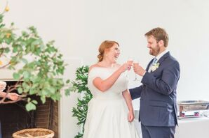 Classic Couple Toasting at Wedding Reception