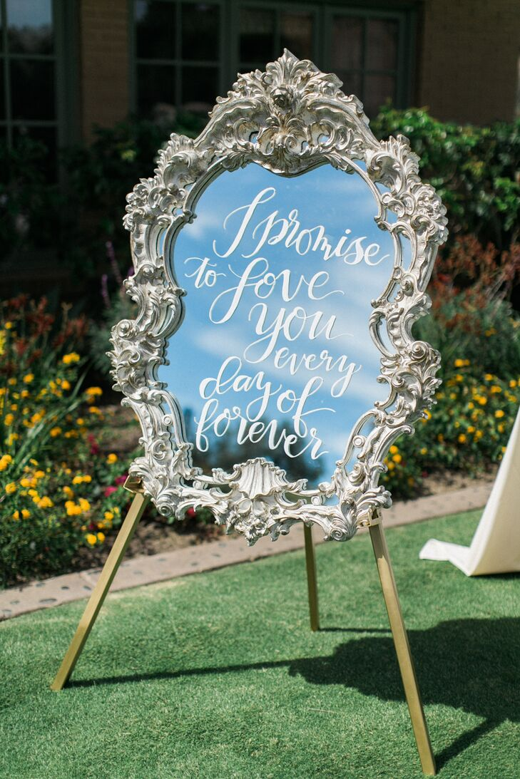 "Several framed mirrors were placed around the ceremony entrance and the reception, each was decorated with calligraphed phrases such as ""I promise to love you every day of forever."""