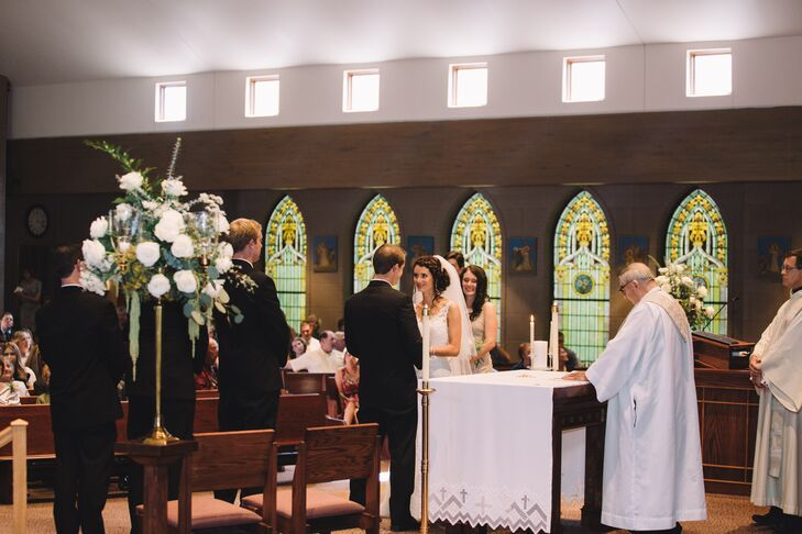 """The only decorations at the church were two big flower arrangements on each side of the altar. """"I wanted the ceremony to be about our marriage and our commitment to each other, rather than about how the church was decorated,"""" she says."""