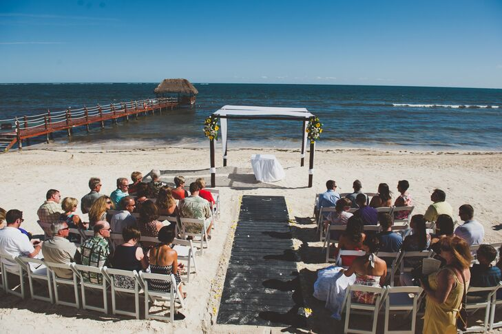 The couple's wedding ceremony took place right on the beach in Riviera Maya, Mexico.