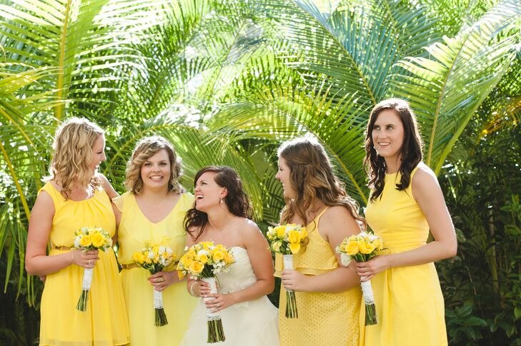 The bridesmaids wore yellow dresses in styles they chose for a laid-back, casual style. Their bouquets were smaller versions of the bride's tropical bouquet.