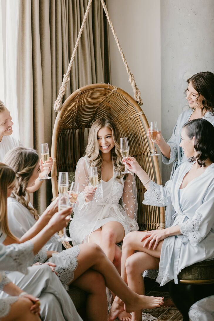 Getting-Ready Champagne Toast with Bride and Bridesmaids Wearing Robes
