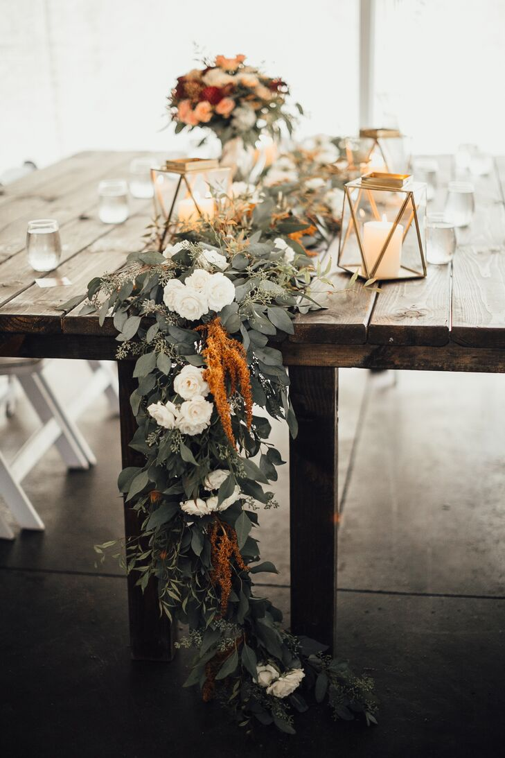 Farm Table with Eucalyptus Garland and Terrariums