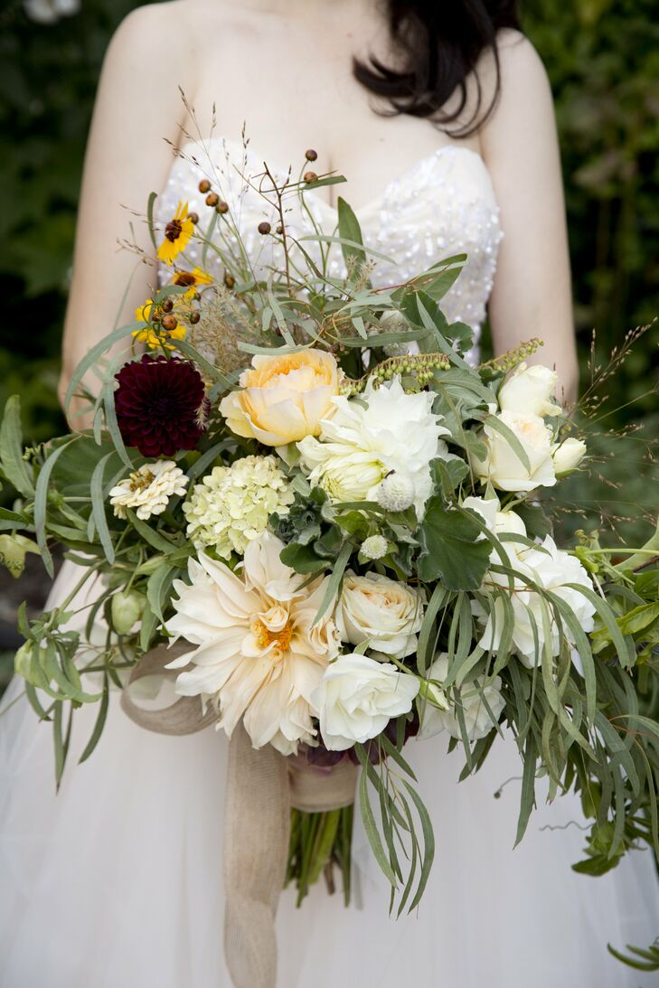 "Erica carried a rustic bouquet of dahlias, garden roses, grasses, succulents and herbs tied with a natural burlap ribbon. ""It was wild and joyful,"" she says."