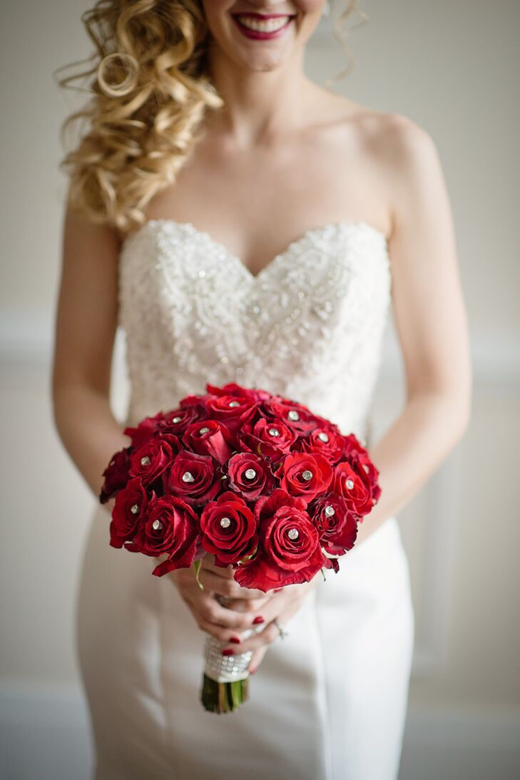 Francesca carried a bouquet of red roses that were accented by festive crystal studs.