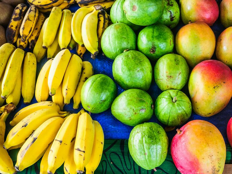 Locally grown fruits of Hawaii, including bananas, Guava, and Mangos at a farmers market in Honolulu.