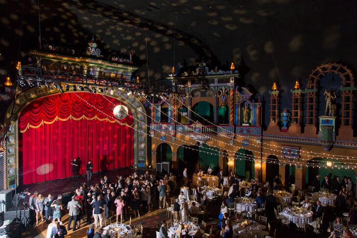 Allie and Liam went to their first concert together to see Deadmau5 at Uptown Theater in Kansas City, Missouri. They loved that the venue had a little history in their relationship. Plus the amazing space was perfect for a glam, upbeat wedding reception.