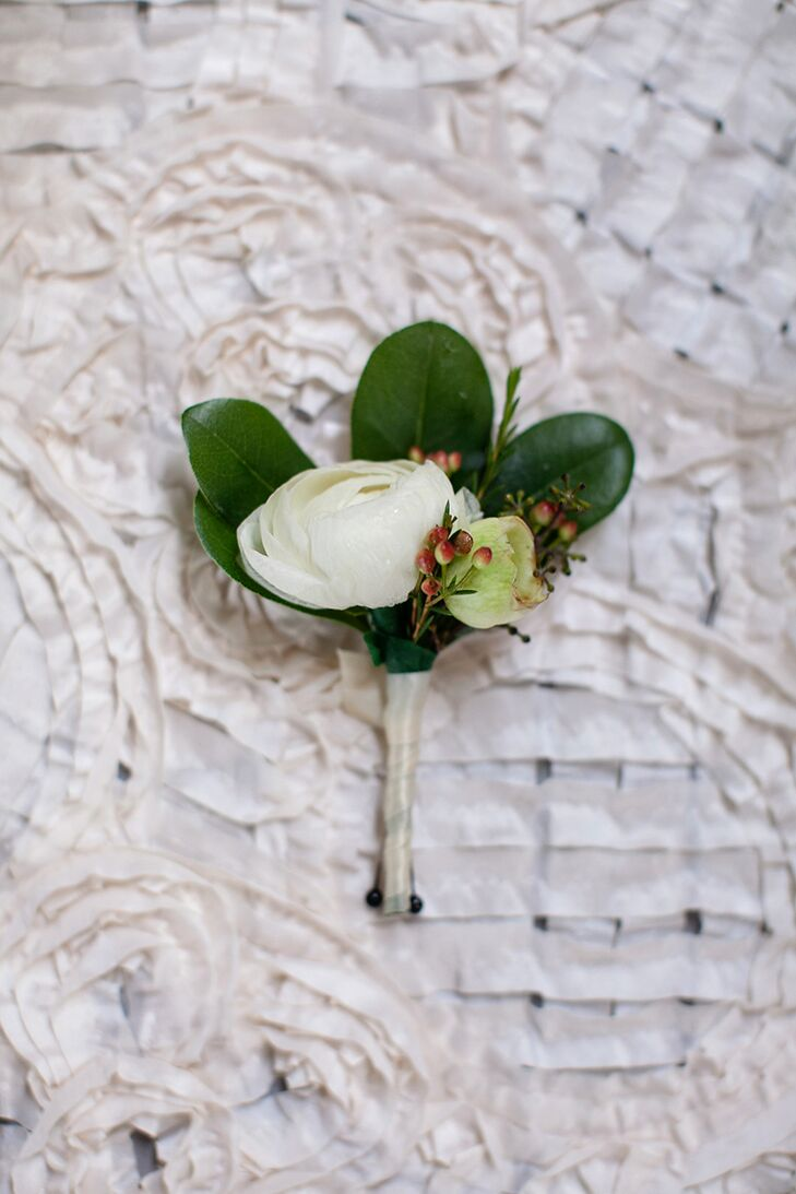 Fresh white peonies surrounded by greenery create this classic boutonniere. They contrasted beautifully against the sharp blue suits worn by Tanner and his groomsmen.