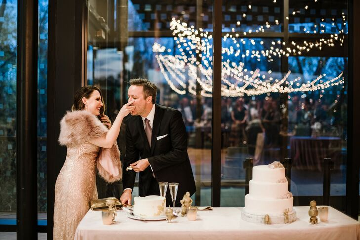 Glamorous Couple Cutting Cake Under String Lights
