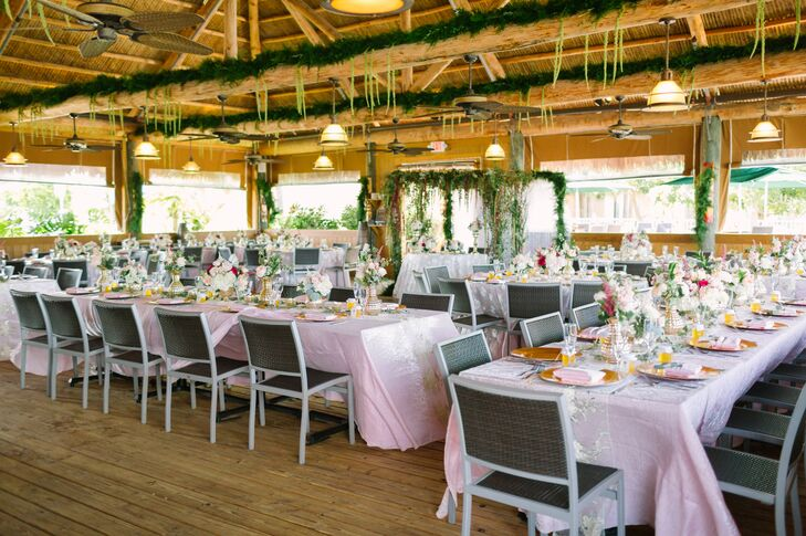 Frank and Katrina decorated their reception venue to fit into their vintage Florida theme by using unstructured, neutral garden roses, hydrangeas and lots of greens.