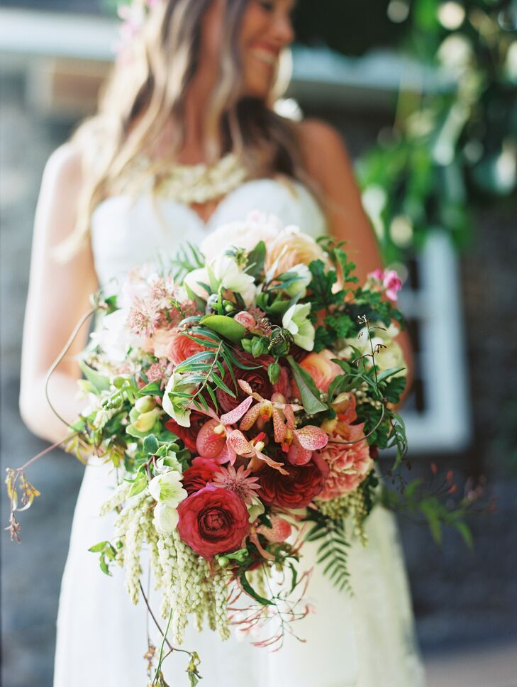 """""""I wanted my bouquet to look like I was walking through a field of wildflowers and just scooped some up,"""" Laura says. """"It was wild with a lot of greenery and flowers going every which way. It was perfect."""""""