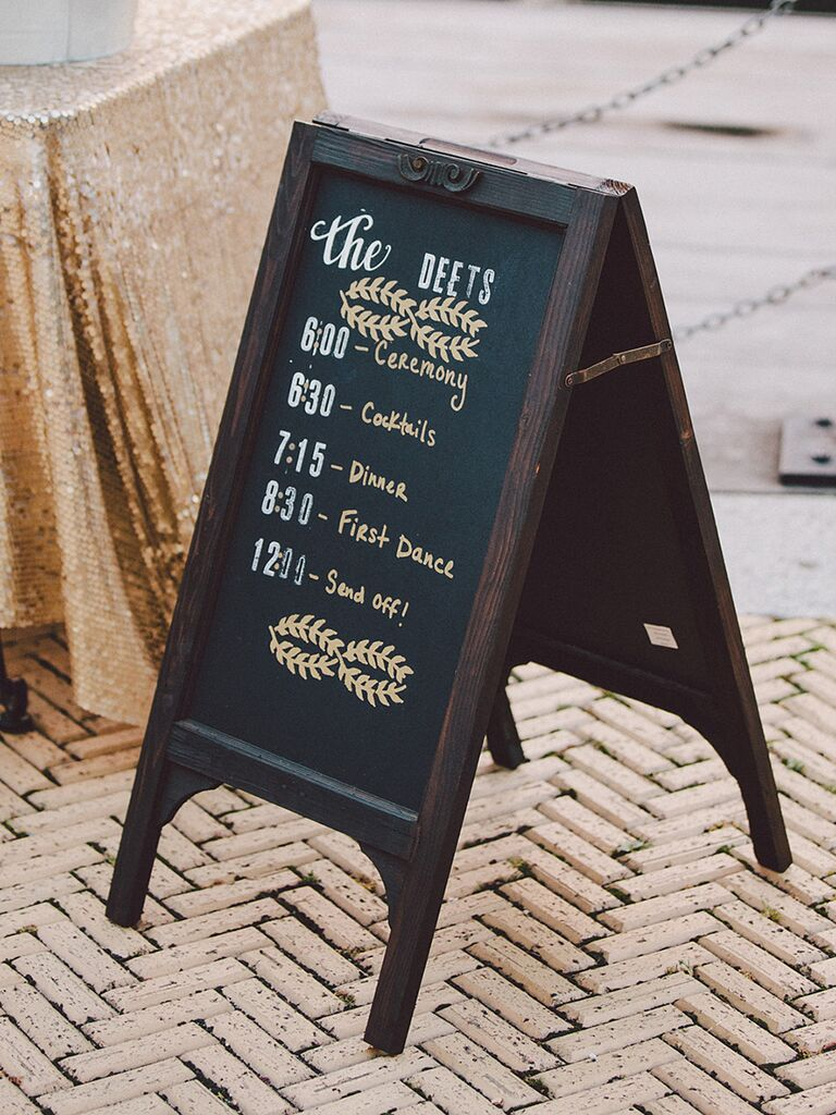 Wedding chalkboard sign with the ceremony and reception schedule