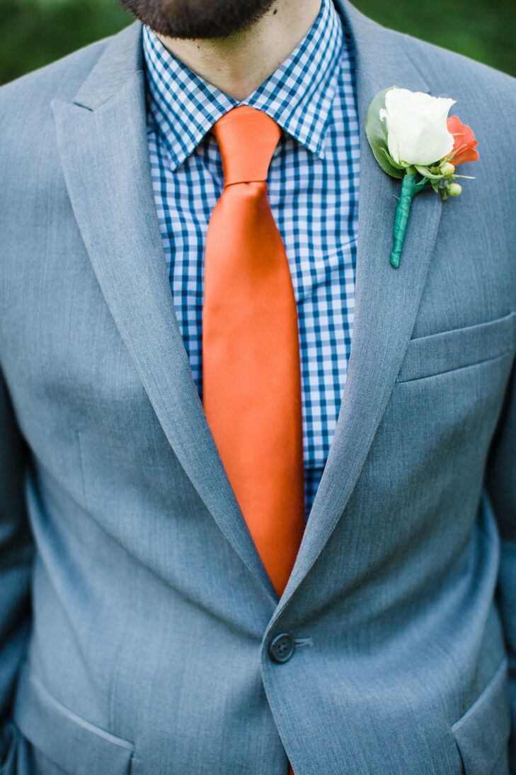 "On his wedding day, Bryan looked dapper in a gray suit, blue gingham shirt and orange tie. ""I love blue and orange, and although I live in Charlottesville, I did not pick those colors because of the University of Virginia,"" Blair says. ""They also happen to be close to the colors of my husband's favorite team, the New York Mets, which helped my cause as well."""