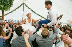 Couple Dancing the Hora with Guests at Tented Reception