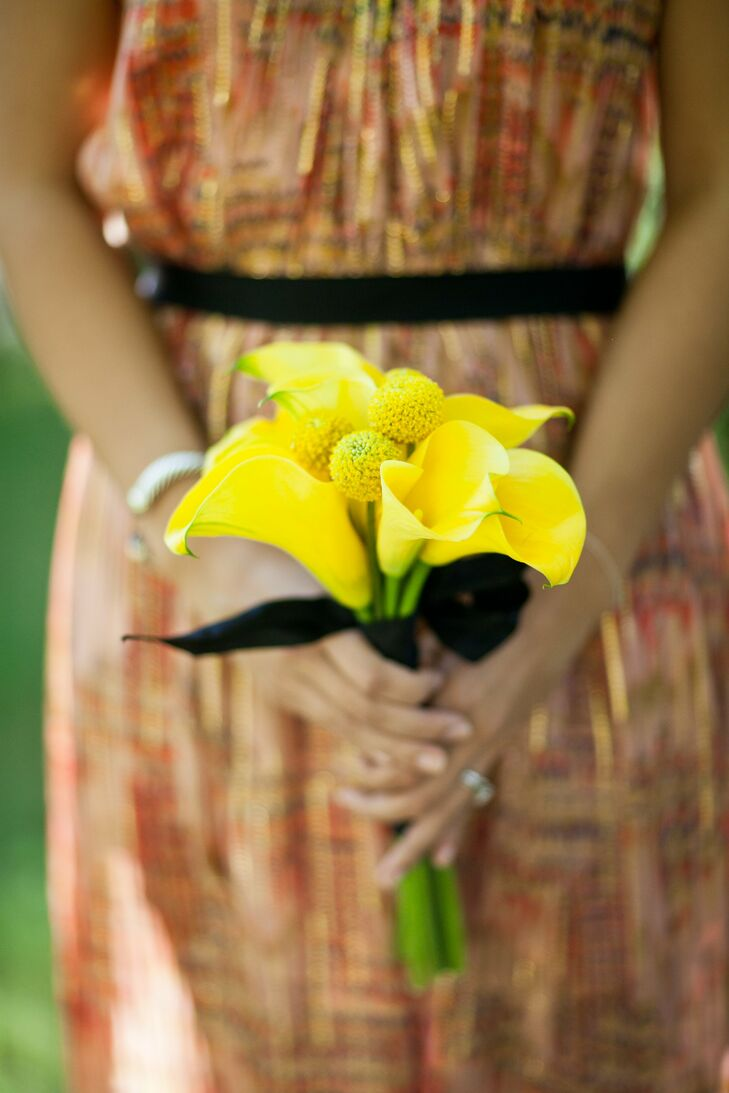 Yellow calla lilies were combined with billy balls for bridesmaid bouquets that really popped against the dresses.