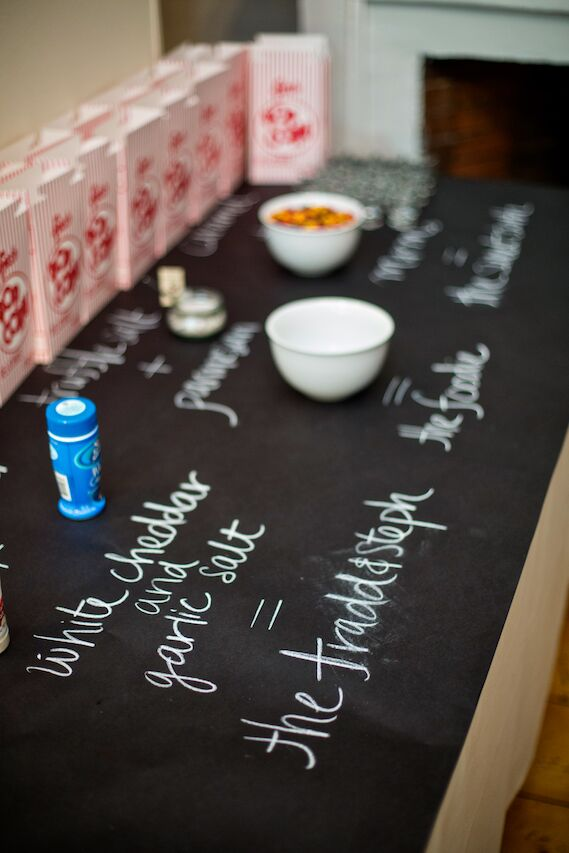 Instead of handing out traditional guest favors, the bride and groom set up a popcorn bar with vintage popcorn boxes from Etsy and various topping choices for guests to snack on at the end of the night.