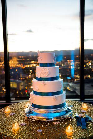 Blue and White Snowflake-Adorned Wedding Cake