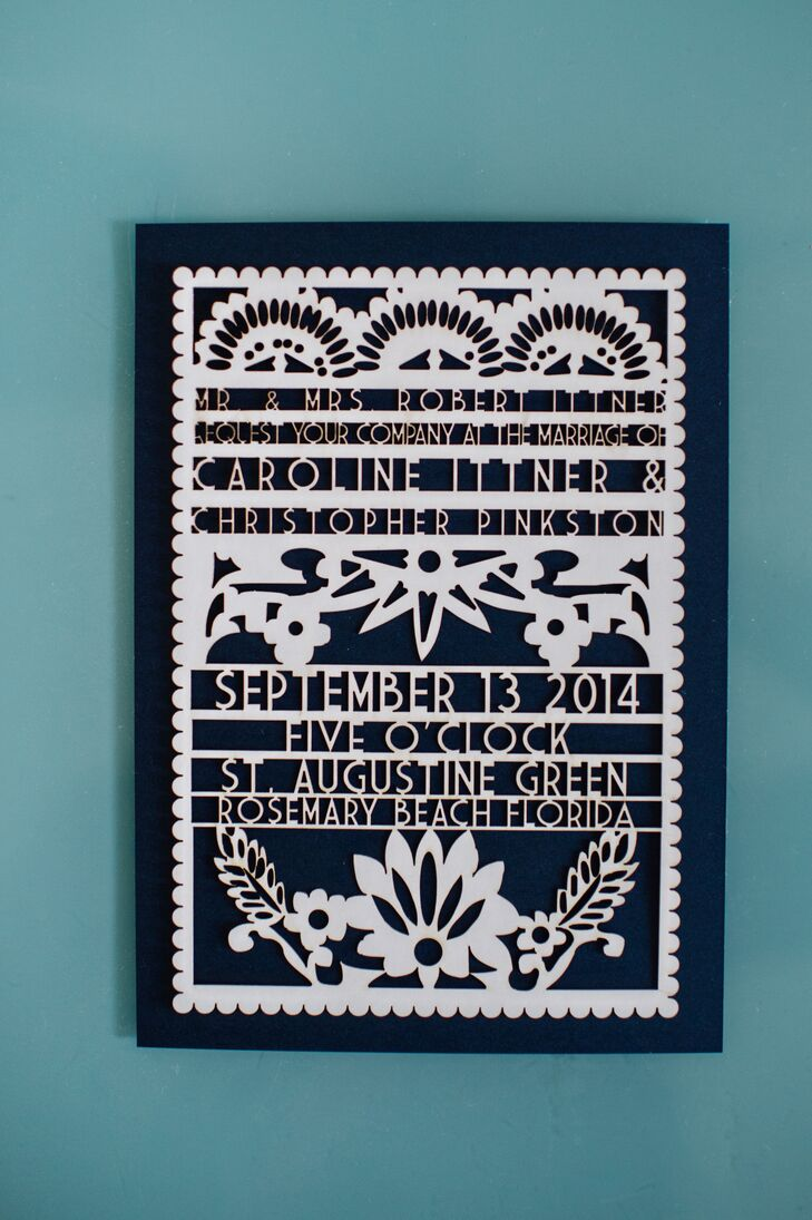 """By working with Studio EQ through Etsy, Caroline and Christopher designed an invitation that resembled the papel picados in their reception. """"I searched high and low on Etsy to find the right person to do it at the right price,"""" Caroline says. Each one had this white floral cut-out design along the front."""
