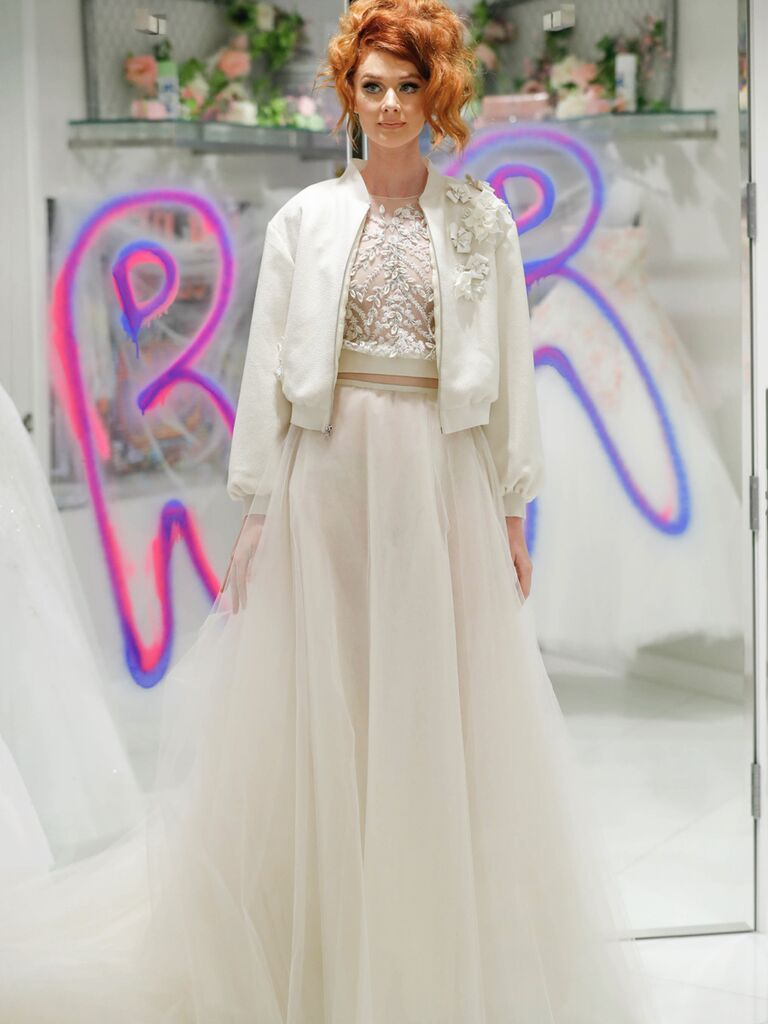 Randi Rahm Fall 2019 Bridal Fashion Week Collection beaded crop top and tulle skirt with bomber jacket