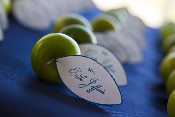 Navy lettered white tags were attached to fresh green apples for the unique (and delicious!) escort cards.