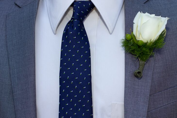 The groomsmen wore gray suits with bold navy ties, and white rose boutonnieres.