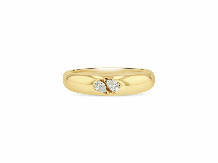 domed yellow gold with two small pear shaped diamonds