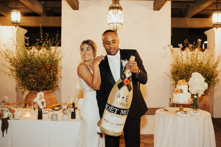 Couple with Large Champagne Bottle in Santa Barbara, California