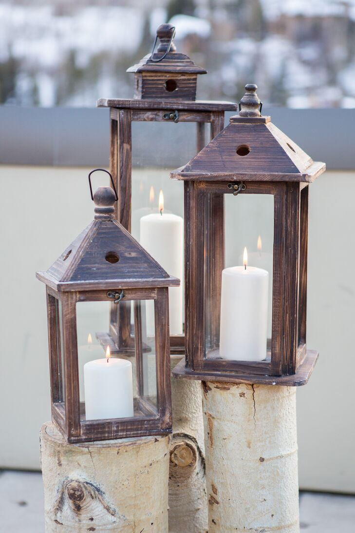 The alter was decorated with rustic Aspen tree logs and wooden lanterns with pillar candles inside.