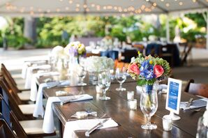 Exposed Wood Tables With Orange and Blue Centerpieces