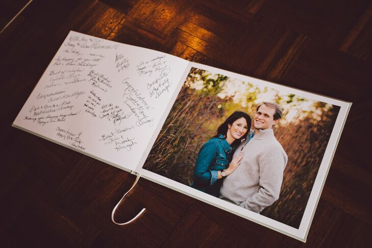 The guestbook featured photos from the couple's engagement shoot with a blank page where guests could leave messages.