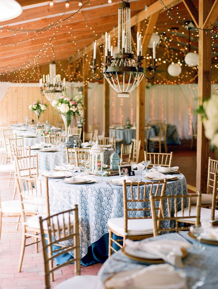 Lantern, candle and floral centerpieces decorated the tables, which were draped with blue and lace tablecloths.
