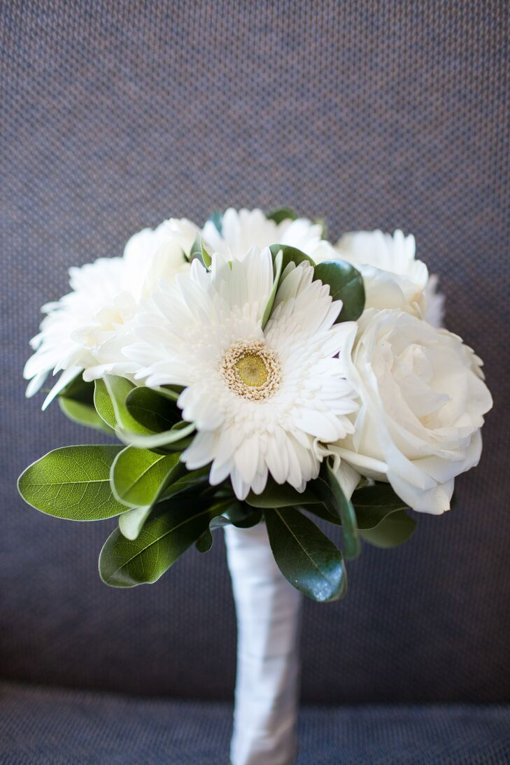 Marni carried a small bouquet with white gerbera daisies and roses.