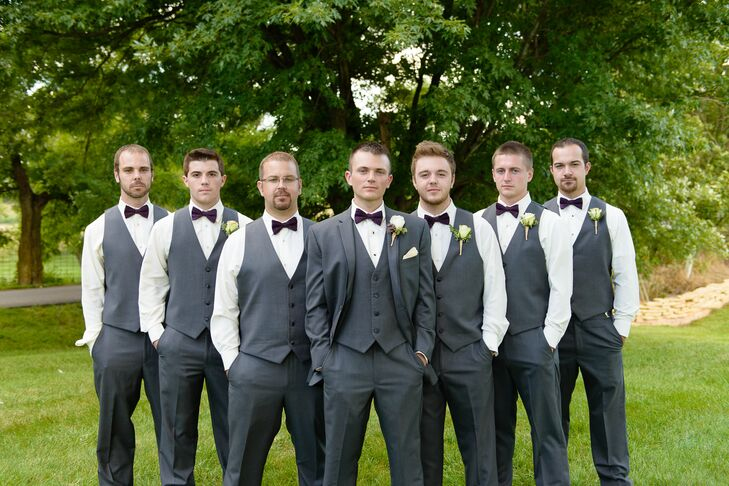 Groomsmen in Dark Grey Tuxedos with Plum Bow Ties and Ivory Rose Boutonnieres