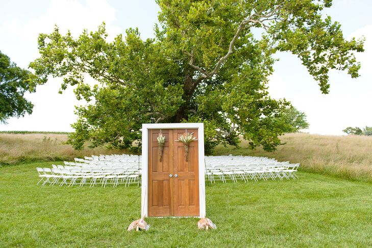 Mark's father created this wooden door frame as entrance to the ceremony.