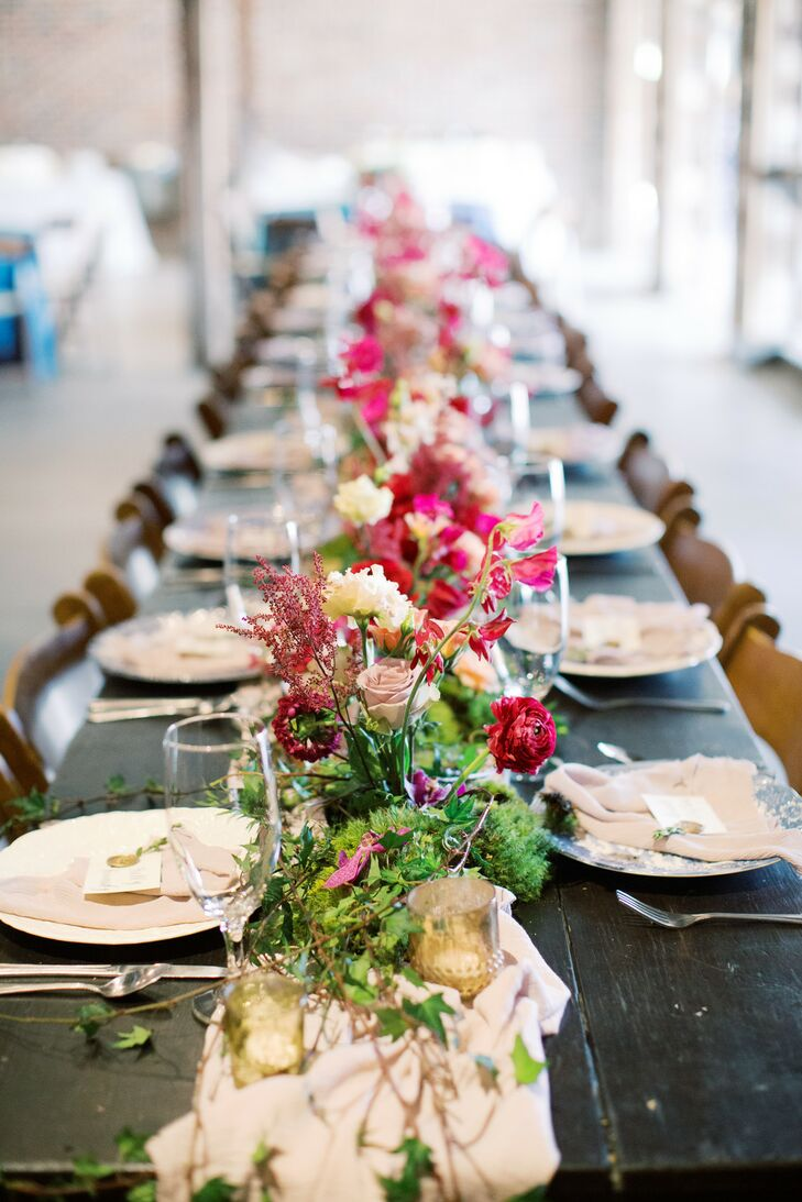 Modern Dining Table With Ivory Runner And Pink Flower Centerpieces