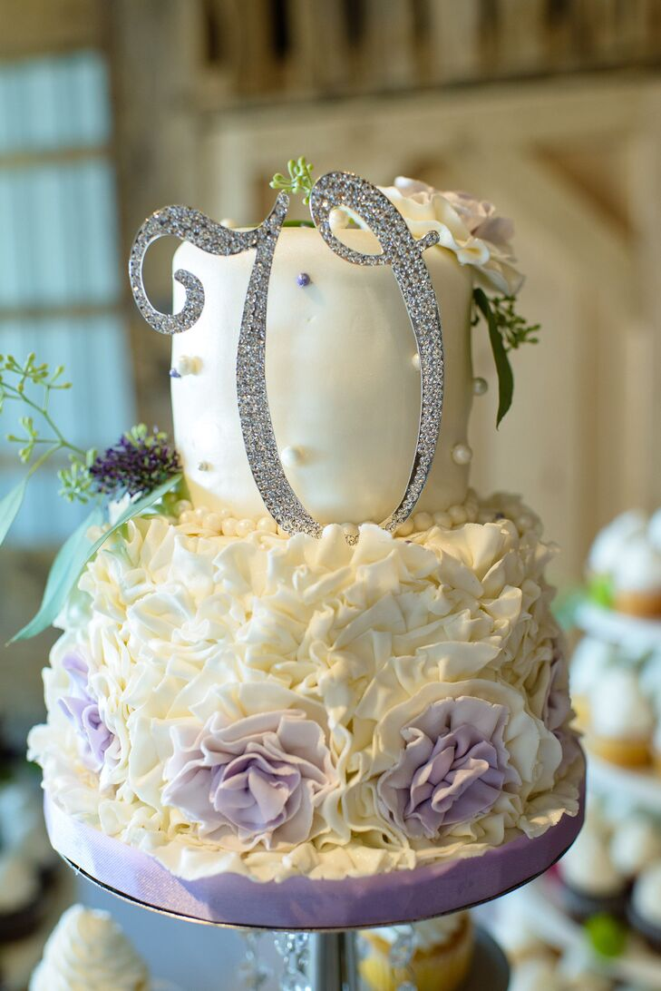 Mark and Amanda chose to have a small wedding cake for themselves while providing guests with an assortment of cupcakes.