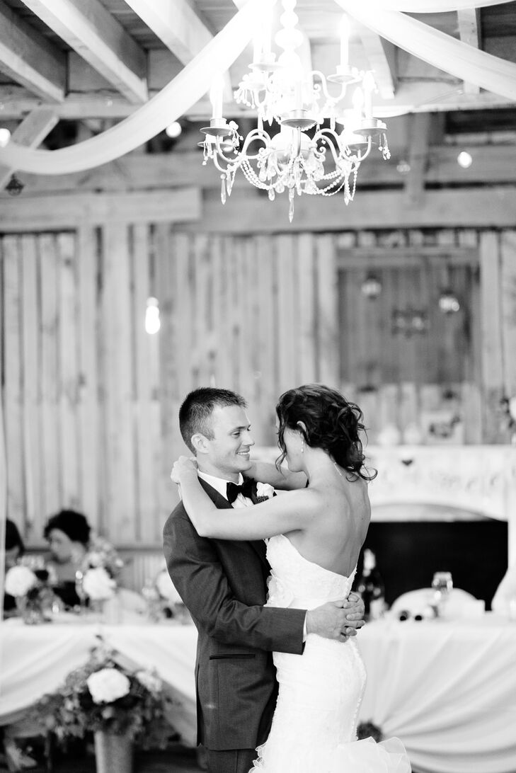 Mark and Amanda share their first dance under a chandelier at their reception at Coffee Creek Ridge.