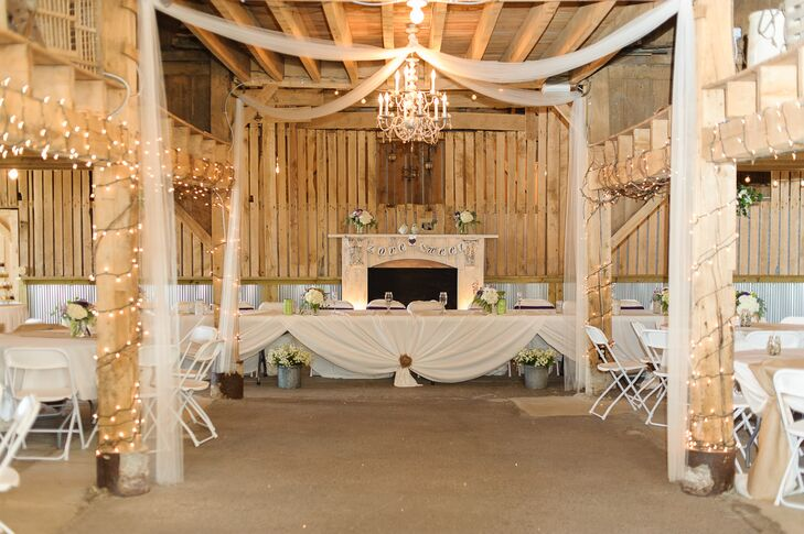 The rustic barn at Coffee Creek Ridge was decorated with white string lights, chandeliers and antique items for the reception.