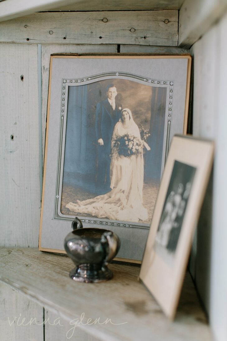 Antique family wedding photos were incorporated into the decor, adding to the vintage-inspired decor, while also honoring the couple's loved ones.