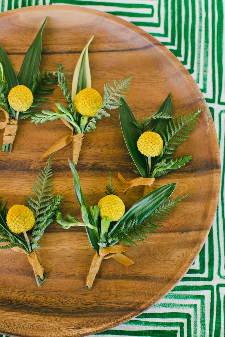"Hawthorn Flower Studio brought Carolyn's modern, colorful vision to life. ""As the main decoration of our wedding, the flowers made everything look amazing,"" says Carolyn, who chose simple golden mimosas for the boutonnieres."